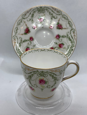 Royal Doulton. Made in England.  Pink Roses. Demitasse Cup and Saucer