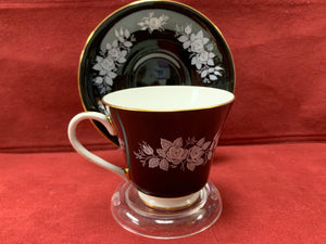 Aynsley, England. Cup and Saucer. Black with White Roses