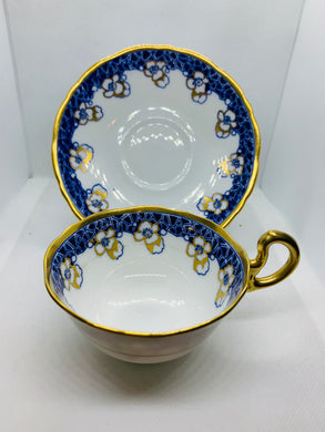 Court China. England. Cup and Saucer. Cobalt Blue Border with White Flowers.