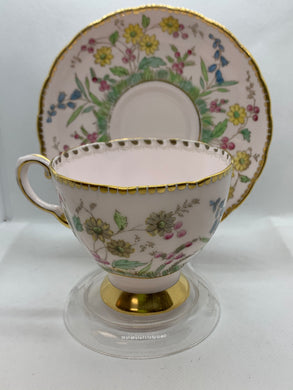 Tuscan, England . Cup and Saucer.  Pink glaze with yellow  daisies.