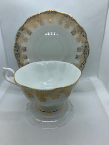 Royal Albert. England. Cup and Saucer.  Gold leaves on white background.