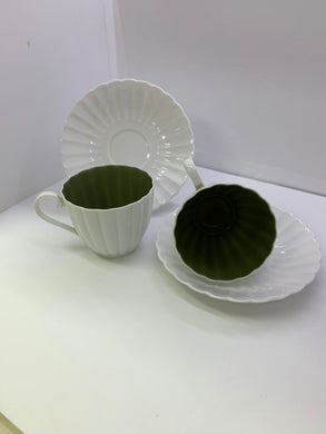 Susie Cooper.  Set of Cup and Saucers.  (2). White ribbed with green interior.