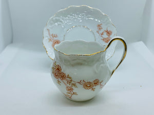 Unmarked,   White with Brown Flowers. Demitasse Cup and Saucer