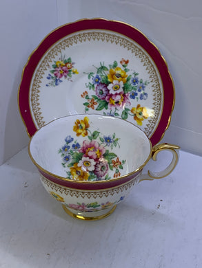 Staffordshire. England. Cup and Saucer.  Mixed Floral with  Burgundy Rim.