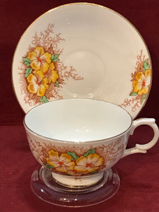 Clarence, England. Cup and Saucer. Yellow Flowers