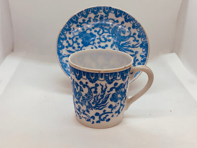 Unmarked. Demitasse Cup and saucer.  Blue and White.
