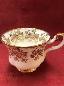 Royal Albert, England. Cup and Saucer.  Gold/White Chintz