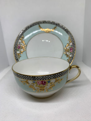 Noritake. Japan. Cup and Saucer.  Soft Green/Blue with roses, black trim.