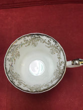 Load image into Gallery viewer, Royal Albert, England. Cup and Saucer. Silver/White Chintz