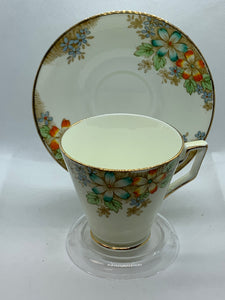 Delphine, England, Cup and Saucer. Multi floral.