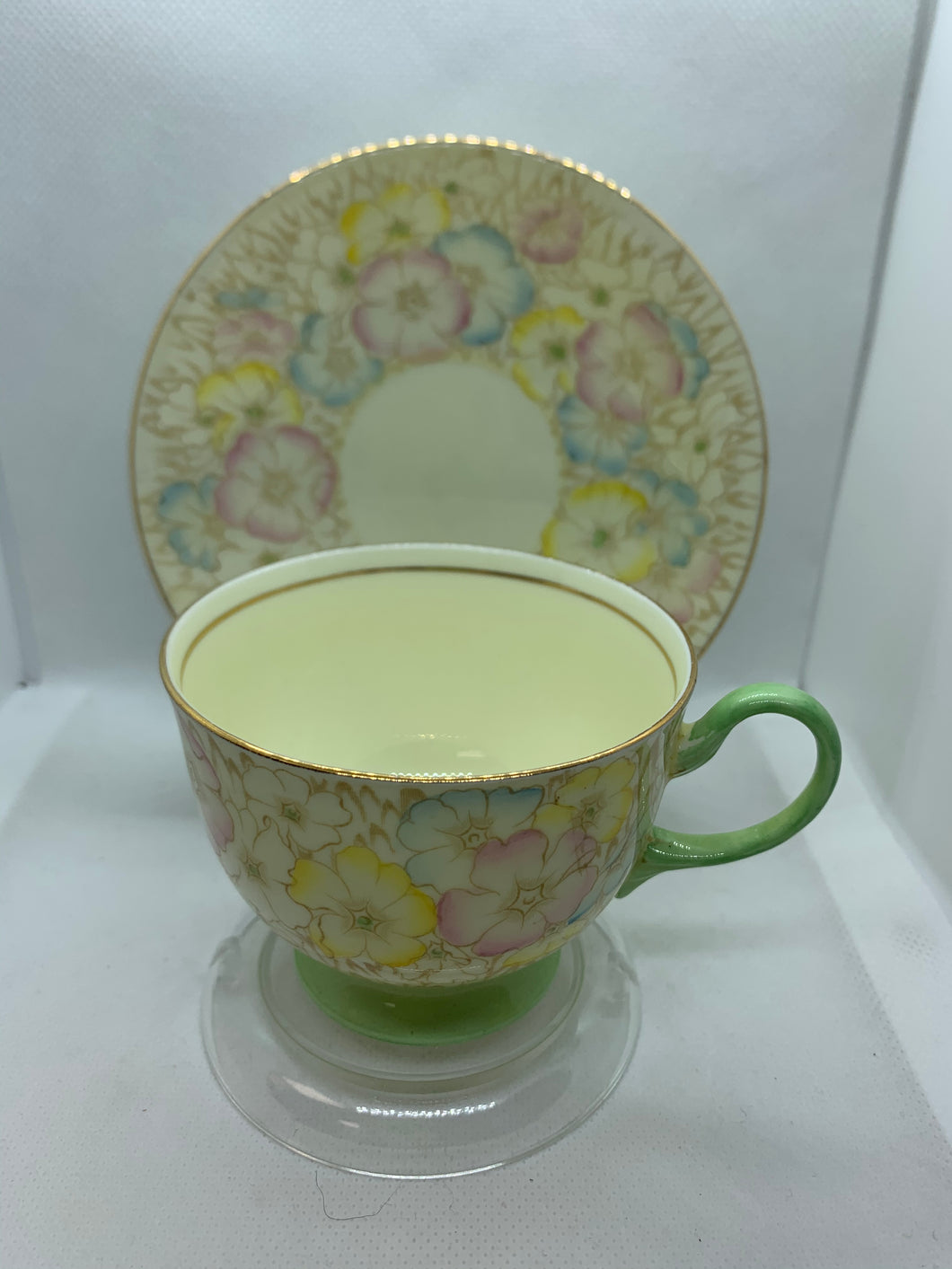 Collingwood. England. Cup and Saucer. Cream with mint green and mixed pastel floral
