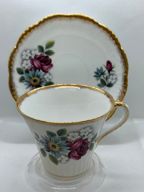 Salisbury, England.  Cup and Saucer.  Blue and White Flowers with Pink Rose
