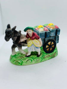 Salt and Pepper. Japan. Girl with Dokey and Cart