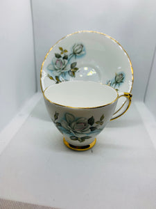 Delphine, England.  Cup and Saucer.   White Roses