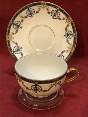Limoges, France. Cup and Saucer.  POY94, by Jean Pouyat