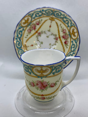 Royal Worcester, England.  Teal/Ivory with Pink Roses. Demitasse Cup and Saucer