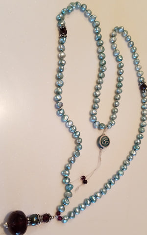 SOLD: Blue pearls with Garnet Focal Beads