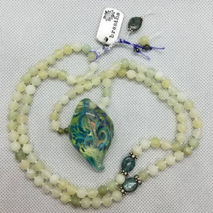 SOLD: Jade beads with lampwork bead by Andy Ray