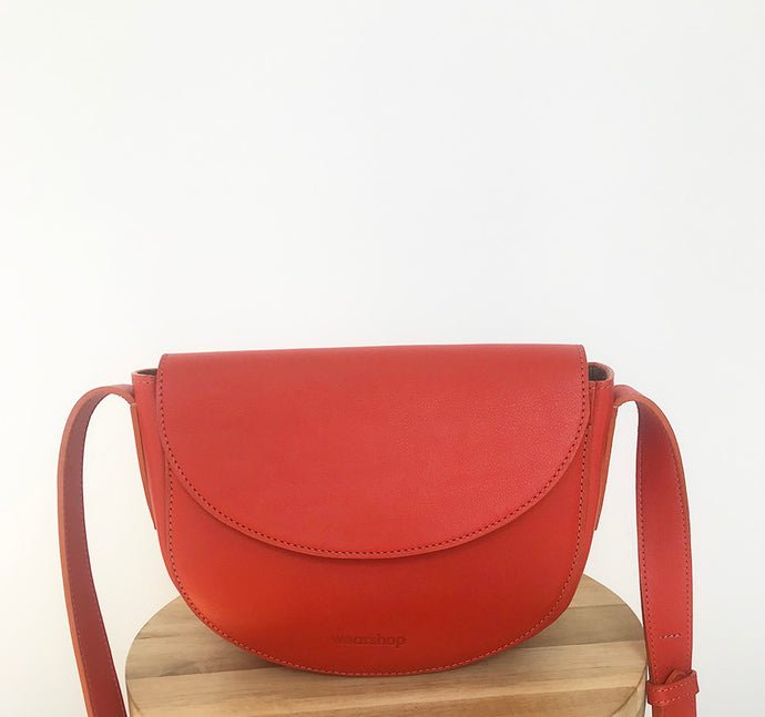 The Corsia crossbody in Bright Orange
