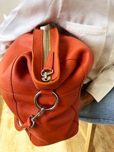 The Meletti soft leather shoulder bag in Mandarin Orange