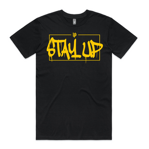"An image of the Undercover Prodigy Gold ""Stay Up"" t-shirt."