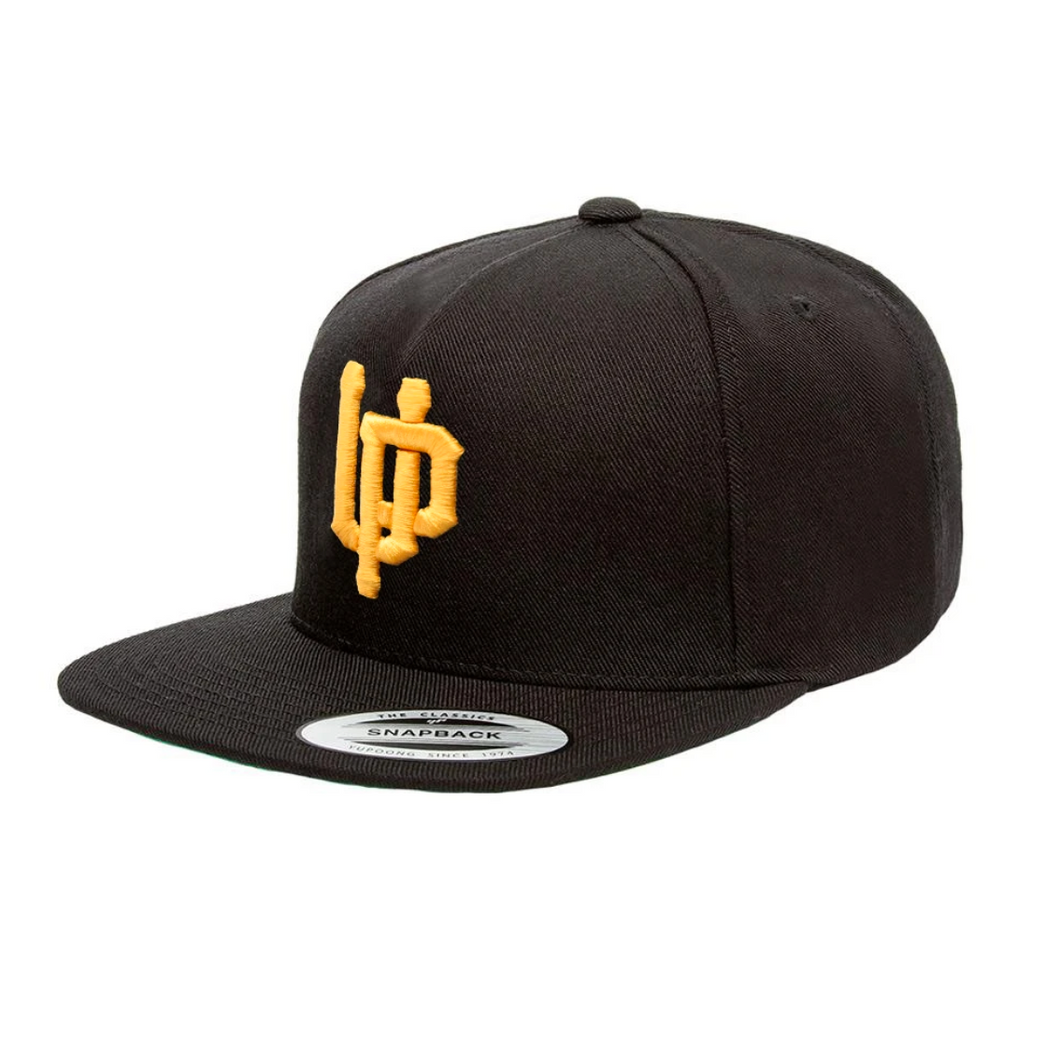 An image of the Undercover Prodigy Gold Embroidered Logo snapback.