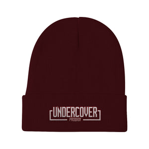 An image of our White Block UP logo beanie in black. /in maroon.