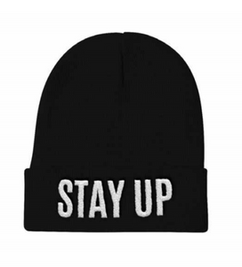 "An image of our black beanie with ""Stay Up"" embroidered on the front."