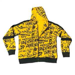 "An image of the Undercover Prodigy ""Gold Script"" zip hoodie."