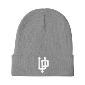 An image of our beanie with an embroidered white UP logo.