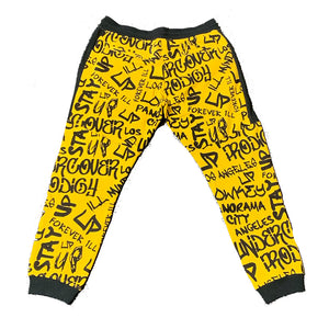 "An image of the Undercover Prodigy ""Gold Script"" joggers."