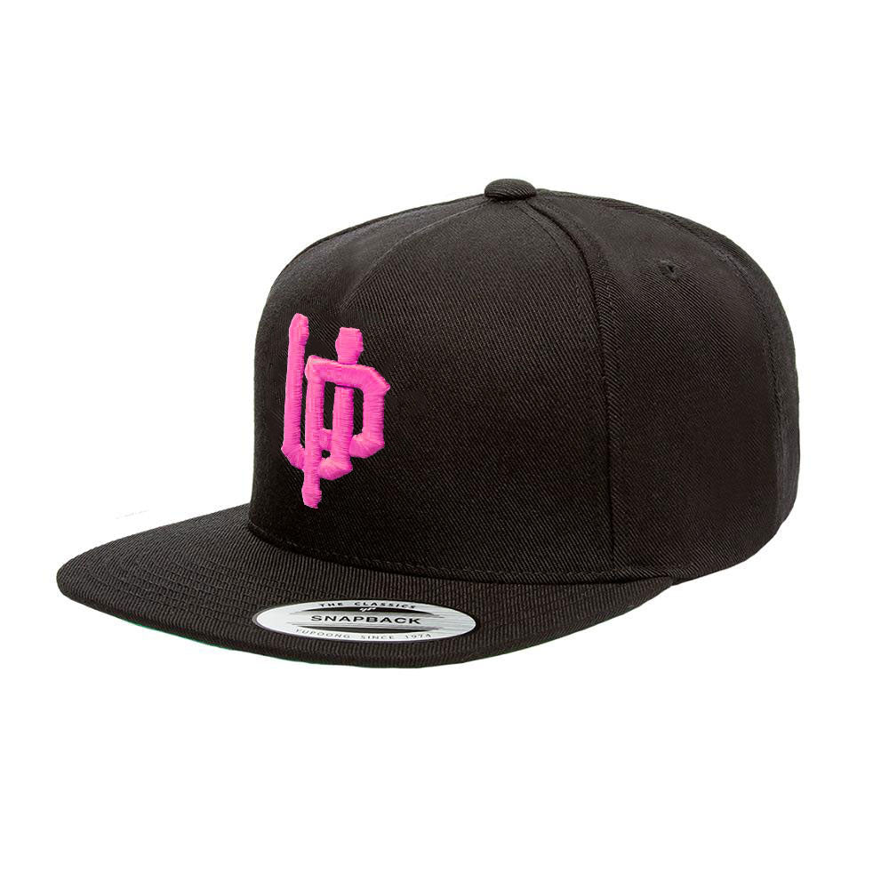 An image of our black snapback with the pink UP logo embroidered on the front.