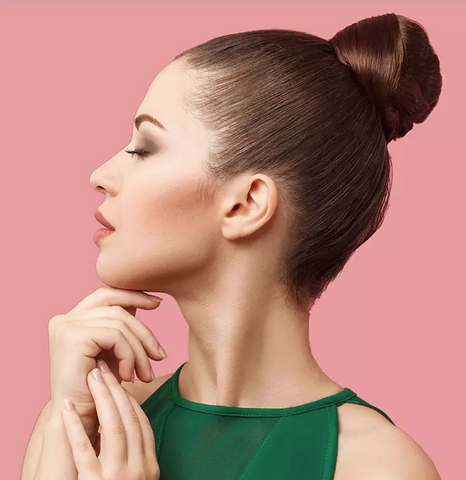 Side view of woman wearing a bun, for Untangled