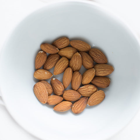 Almonds in a white bowl, for Untangled