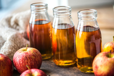Bottles of apple cider vinegar, for Untangled