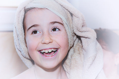 Little girl with her hair wrapped in a towel, for Untangled