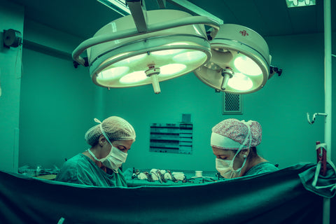 Two doctors in operating room doing surgery, for Untangled