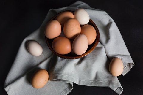 Brown and white eggs inside a bowl, for Untangled