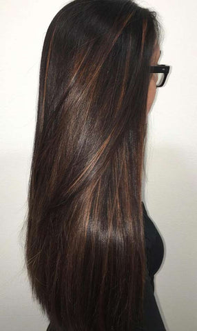 Woman showing off hair with mocha highlights, for Untangled