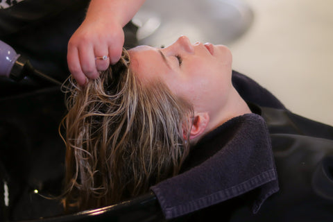 Lady with her hair getting treated, for Untangled
