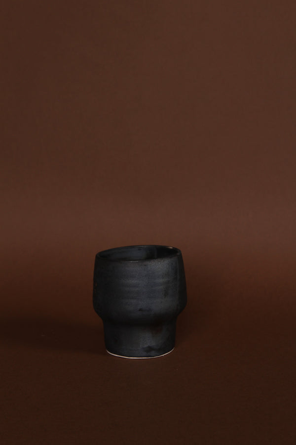 Asymmetrical black cup