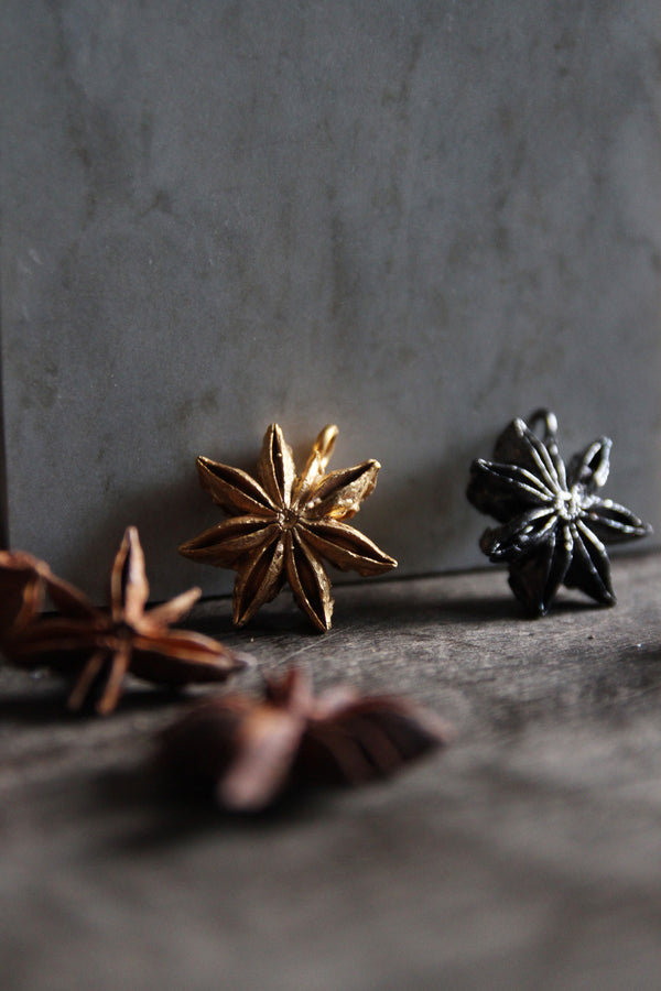 Star anise in brass plated with 24K gold or black-headed silver