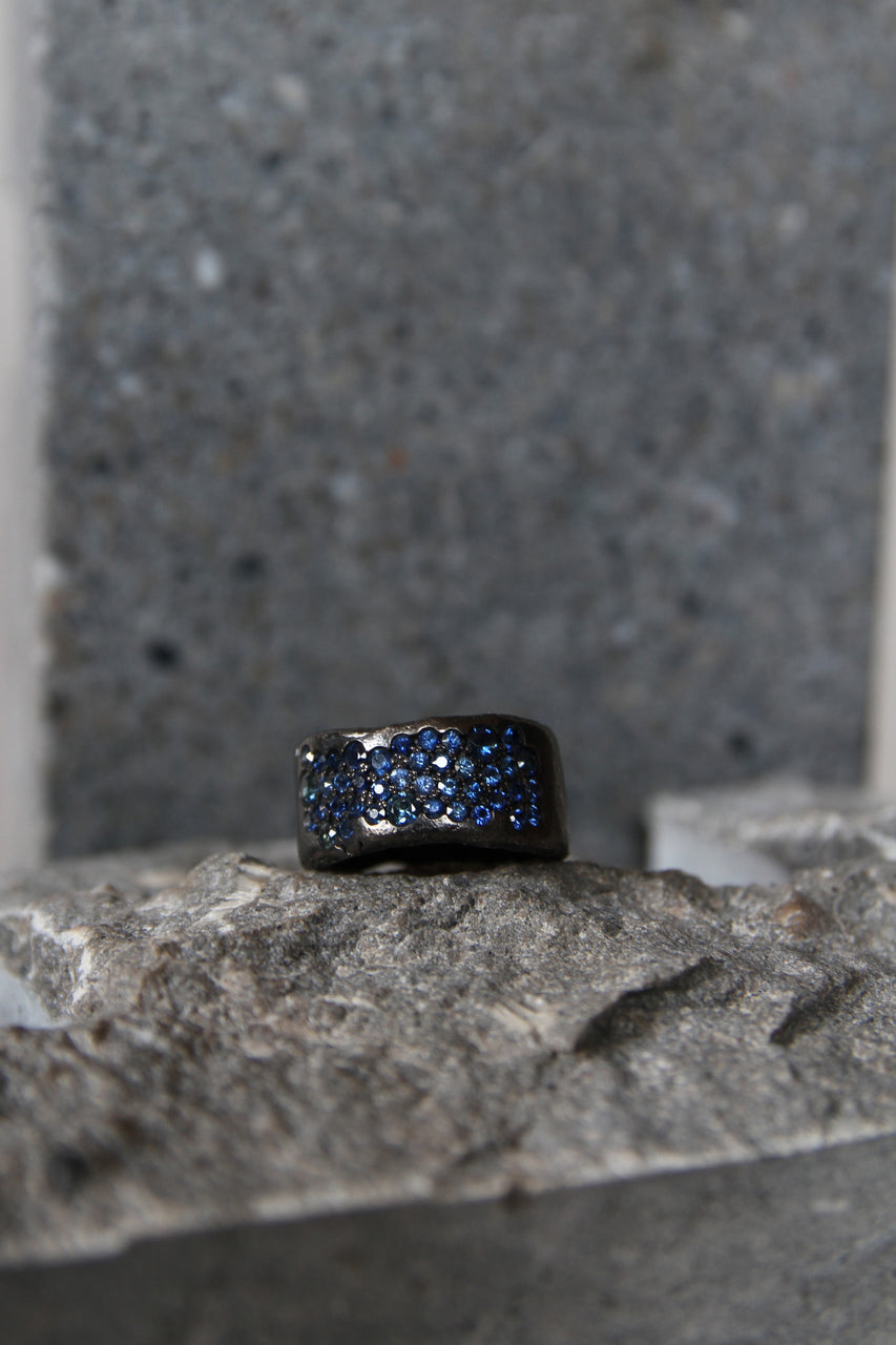 Wide blackhead Silver ring with 44 sapphires