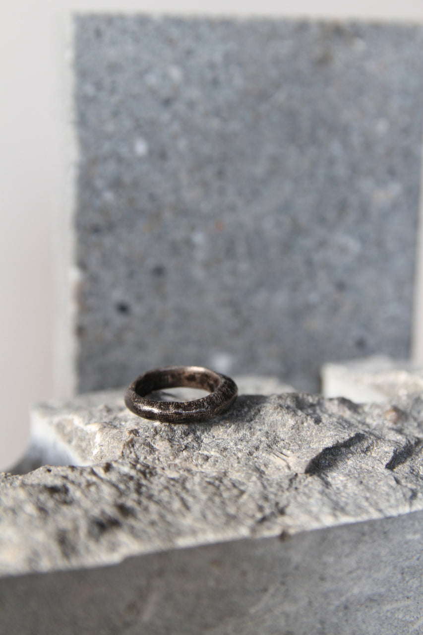 Thin black-headed silver ring