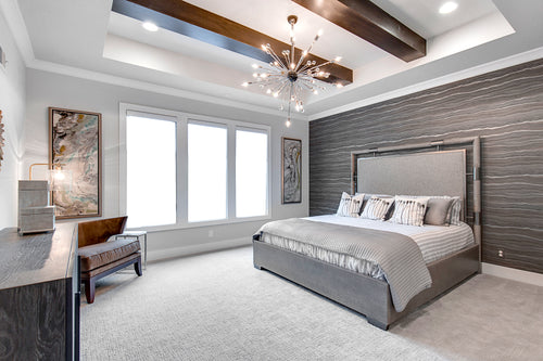 Gray Bedroom with Wood Beams