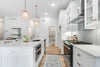 White Kitchen with Gray Tile