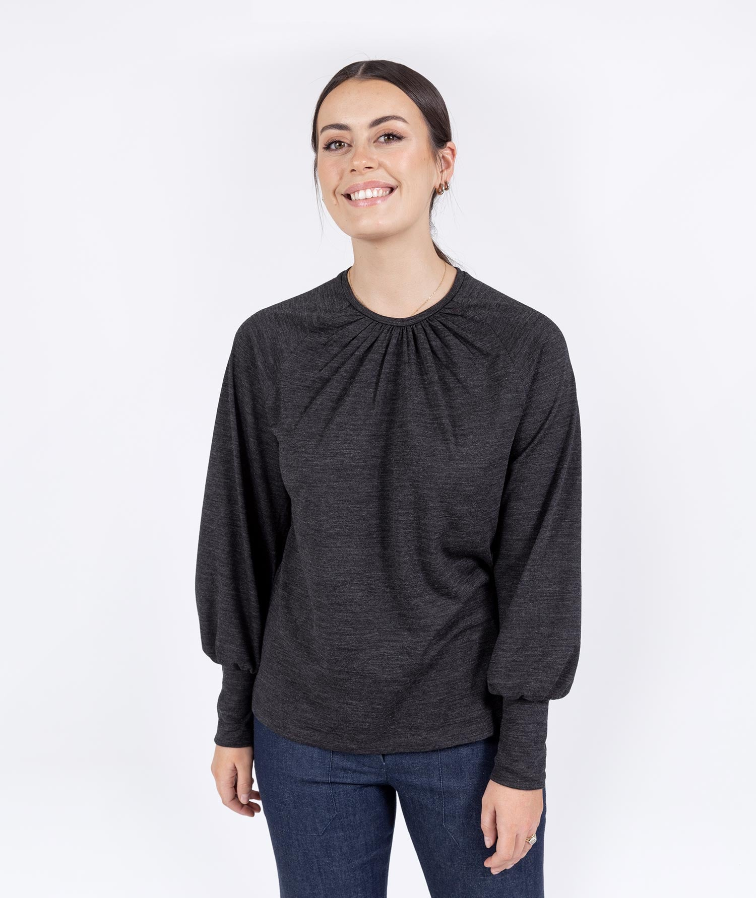 Full sleeve charcoal top with flare indigo pant