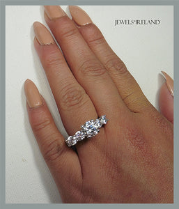 Immense sparkle - 5 stone with raised central stone non mined diamond ring.