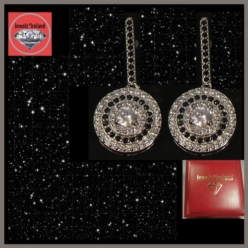 Luxury created diamond combination of black and white stone dangle earrings.