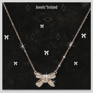 Bow shaped necklace with created diamonds